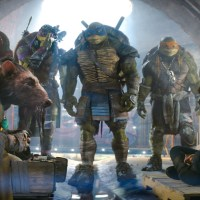 Left to right: Raphael, Splinter, Donatello, Leonardo, Michelangelo, and Megan Fox as April O'Neil in TEENAGE MUTANT NINJA TURTLES, from Paramount Pictures and Nickelodeon Movies.