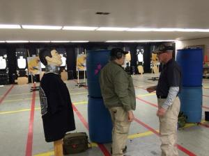 """Dave briefing a student before the """"robot"""" drill.  Robot on left.  From Handgun Combatives Facebook Page."""