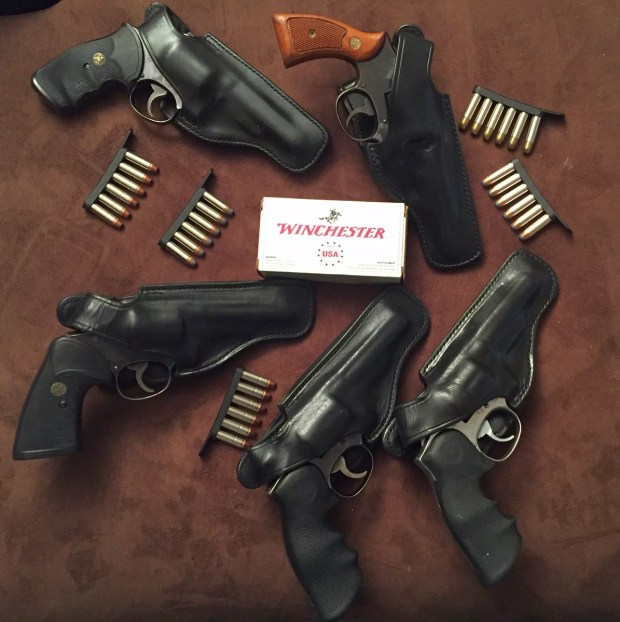 """A few of the police trade revolvers I've picked up for cheap prices over the year. With holsters and ammo included, these five guns still cost less than the price of a single AR-15 rifle.  Which would be a better bet in a survival situation: five friends with hidden .38 revolvers or one friend with that new AR-15 you put in the safe """"just in case""""?"""