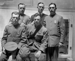 August 22, 1925: Oscar Bayer (sitting on right) next to Bertrand M. Steventon. Standing left to right are Claude R. Weaver, Charles Meyers and Jack A. Stambler. This photo was published in the Aug. 23, 1925 Los Angeles Times but Meyers was removed from image by a staff artist.