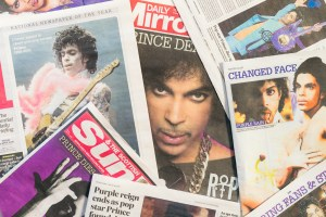Edinburgh, UK - April 22, 2016: A selection of British newspapers featuring the musician Prince, following news of his death on April 21, 2016. Born in Minneapolis in 1958, Prince received widespread appreciation for his musical innovation and skill, as well as his commercial success.