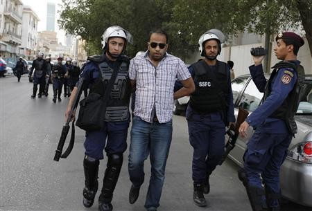 An anti-government protester is arrested by riot police during a protest in front of Ministry of Interior in Manama, April 27, 2012. REUTERS/Hamad I Mohammed