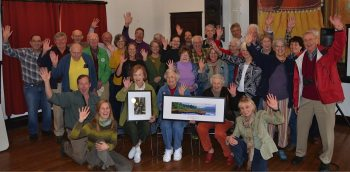 Participants at Adirondack Wild's annual meeting at The Grange in Whallonsburg send greetings to Gary Randorf, recipient of the Paul Schaefer Wilderness Award.