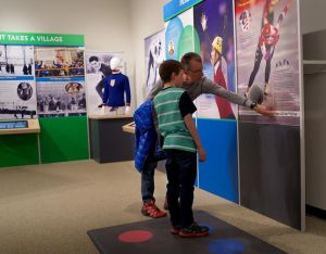 Visitors to the Quest for Speed exhibit try the Skate to the Beat activity
