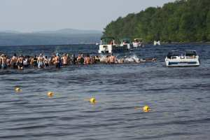 Swimmers kick off the 2015 Piseco Lake Triathlon in a flurry of splashes. This year's race is July 16.