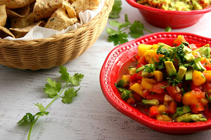 Get ready for a flavor explosion of deliciousness with this Avocado Mango Salsa recipe! This crowd pleaser is great as a party appetizer served with chips, or served as an accompaniment to seafood or chicken.