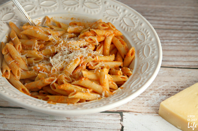 This Lightened Up Pink Vodka Sauce recipe, served over pasta, is a delicious easy meal when you need to get dinner on the table fast! It makes enough sauce for two pounds of pasta, so freeze your leftover sauce for another night. Created for Cooking for a Cure to bring awareness to Breast Cancer Awareness Month. Vegetarian