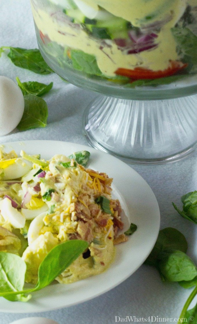 This delicious Creamy Deviled Egg Layered Pasta Salad recipe combines deviled eggs and pasta salad in a dish that is perfect for Easter, Mother's Day, or any potluck get together. The dressing is creamy, egg-y and bold...I think it is the best dressing I have ever made! This is sure to be one of the most popular side dishes at your next get together or holiday dinner!