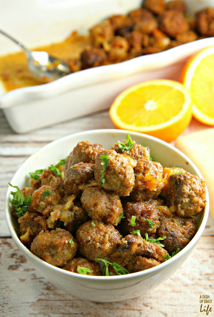 Slow Cooker Pork Meatballs with Orange Sauce...tender, juicy meatballs, packed with vegetables, covered with an orange glaze that everyone goes crazy for! Great as a party appetizer recipe, or delicious easy dinner with rice! Leftovers freeze well.