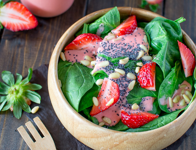 Colorful and healthy, this Simple Spinach and Strawberry Salad recipe makes a great lunch and can be easily customized for dinner by adding grilled chicken and feta. The strawberry dressing is the best in the world!