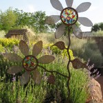 Yard art, glass and steel flower