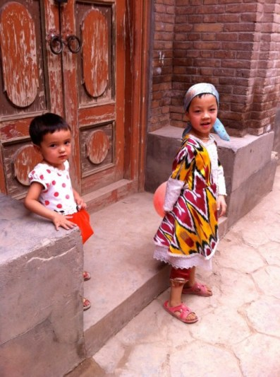 Girls playing in a traditional Uighur neighborhood in Urumqi