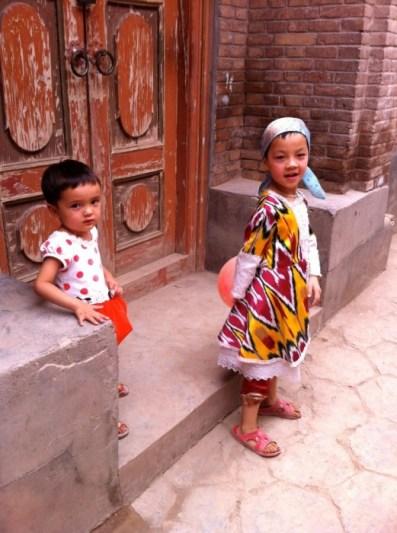 Girls playing in a traditional Uighur neighborhood in Urumqi