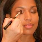 chase applying eye makeup