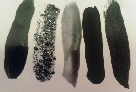 """here all all five of the nail polishes in order from 702-708.  As you can see, not all """"black polish"""" is the same. Which is ones are your favorites?"""