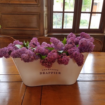 the intoxicating fragrance of fresh-cut lilacs greeted us at Drappier