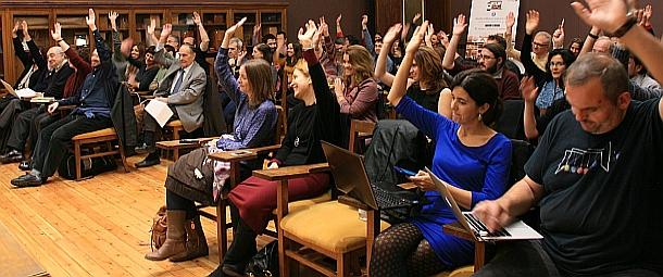 encuentro-socios-2016-asamblea-manos-slide
