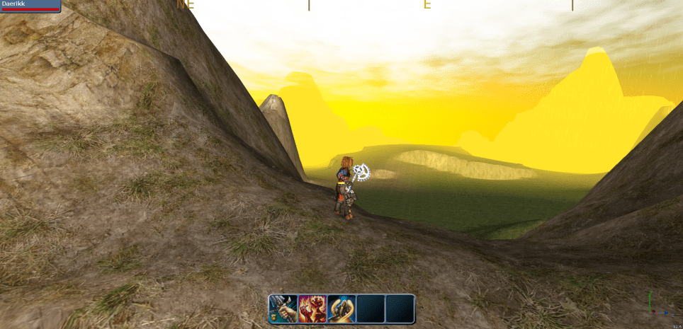 Character standing in a mountain pass with glowing yellow fog in the distance.