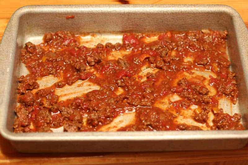 Add meat sauce to bottom of casserole pan.