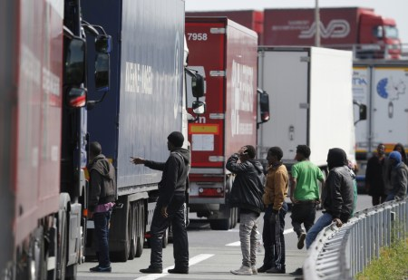 In broad daylight, migrants look for UK-bound lorries to board