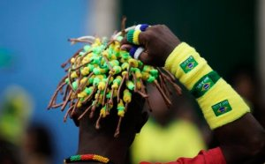 An Olodum band member gestures during the FIFA World Cup soccer match between Brazil and North Korea in Salvador