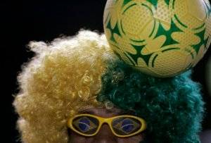 A Brazil fan waits for the start of the 2010 World Cup qualifying soccer match between Brazil and Ecuador in Maracana stadium in Rio de Janeiro
