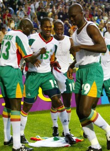 Senegal team mates, Lamine Diatta (L), Salif Diao (C), Khalilou Fadiga (R Rear) dance on Papa Bouba ..