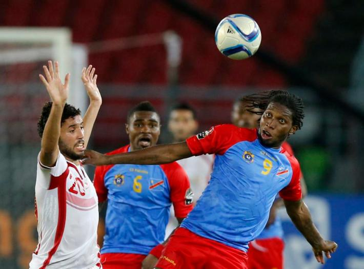Democratic Republic of Congo's Dieumerci Mbokani challenges Tunisia's Mohamed Ali Yaakoubi  during their Group B soccer match of the 2015 African Cup of Nations in Bata
