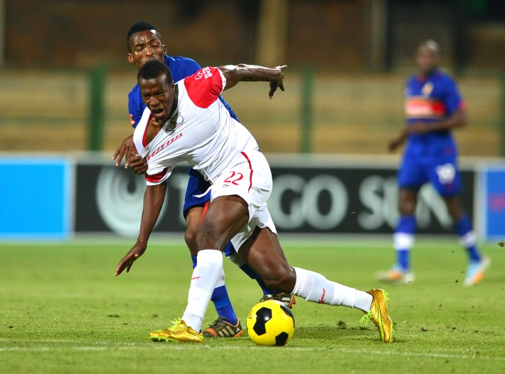 PRETORIA, SOUTH AFRICA - AUGUST 27: Vuyisili Ntombiayithethi of Tuks and Camaldine Abraw of the All Stars battle for the ball during the Absa Premiership match between University of Pretoria and Free State Stars at Tuks Stadium on August 27, 2014 in Pretoria, South Africa. (Photo by Johan Rynners/Gallo Images)