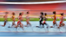 Athletes compete in a women's 5000-meter heat at the World Athletics Championships in the Luzhniki stadium in Moscow, Russia, Wednesday, Aug. 14, 2013. (AP Photo/Martin Meissner)
