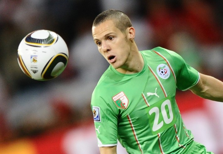 Algeria's defender Djamel Mesbah eyes the ball during the 2010 World Cup group C first round football match between England and Algeria on June 18, 2010 at Green Point stadium in Cape Town. The match ended in a 0-0 draw. NO PUSH TO MOBILE / MOBILE USE SOLELY WITHIN EDITORIAL ARTICLE - AFP PHOTO / JEWEL SAMAD (Photo credit should read JEWEL SAMAD/AFP/Getty Images)
