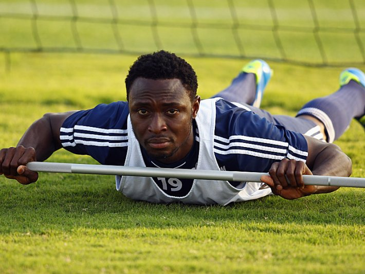 DOHA, QATAR - JANUARY 06: Chinedu Obasi exercises during a training session of Schalke 04 at the ASPIRE Academy for Sports Excellence on January 6, 2012 in Doha, Qatar.  (Photo by Alex Grimm/Bongarts/Getty Images)