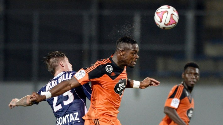 Lorient's French Ivorian defender Lamine Kone (R) vies with Evian's French forward Nicki Nielsen during the French L1 football match between Lorient (FCL) and  Evian Thonon Gaillard (ETGFC) on September 27, 2014 at the Moustoir stadium in Lorient, western France. AFP PHOTO / JEAN-SEBASTIEN EVRARD        (Photo credit should read JEAN-SEBASTIEN EVRARD/AFP/Getty Images)