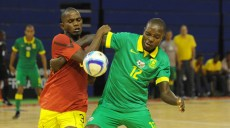Wiseman Cele of South Africa is challenged by Manuel Francisco of Mozambique during the Futsal African Cup of Nations match between South Africa and Mozambique on 15 April 2016 at Ellis Park Stadium Pic Sydney Mahlangu/ BackpagePix