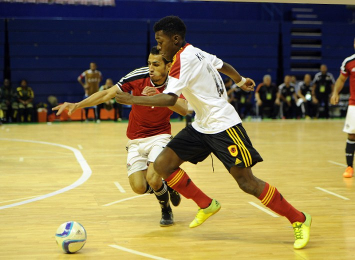 Ibrahim Ibrahim  of Egypt challenges Osvaldo Inacio of Angola  during the CAF Futsal Africa Cup of Nations match between Egypt and Angola  on 18 April 2016 at Ellis Park Stadium Pic Sydney Mahlangu/ BackpagePix