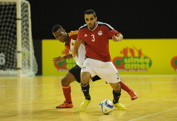 Abdelrahman Moawad  of Egypt is challenged by Artur Da Silva  of Angola  during the CAF Futsal Africa Cup of Nations match between Egypt and Angola  on 18 April 2016 at Ellis Park Stadium Pic Sydney Mahlangu/ BackpagePix