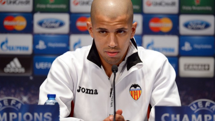 Valencia's Algerian midfielder Sofiane Feghouli gives a press conference at the Parc des Princes stadium in Paris, on the eve of an UEFA Champions League round of 16 second leg football match against Paris Saint-Germain (PSG).   AFP PHOTO / FRANCK FIFE        (Photo credit should read FRANCK FIFE/AFP/Getty Images)
