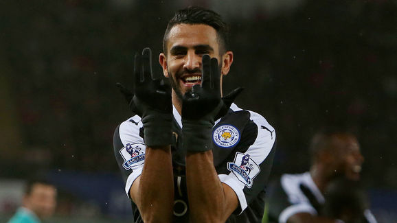 Leicester City's Algerian midfielder Riyad Mahrez celebrates after scoring his third goal during the English Premier League football match between Swansea City and Leicester City at The Liberty Stadium in Swansea, south Wales on December 5, 2015.       AFP PHOTO / GEOFF CADDICKRESTRICTED TO EDITORIAL USE. No use with unauthorized audio, video, data, fixture lists, club/league logos or 'live' services. Online in-match use limited to 75 images, no video emulation. No use in betting, games or single club/league/player publications. / AFP / GEOFF CADDICK        (Photo credit should read GEOFF CADDICK/AFP/Getty Images)