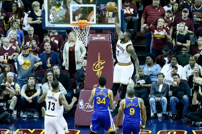 08 June 2016: Cleveland Cavaliers forward LeBron James (23) goes for the dunk on a pass by Cleveland Cavaliers guard Kyrie Irving (2) during the Cleveland Cavaliers 120-90 victory over the Golden State Warriors, during Game Three of the 2016 NBA Finals at the Quicken Loans Arena, Cleveland, Ohio, USA.