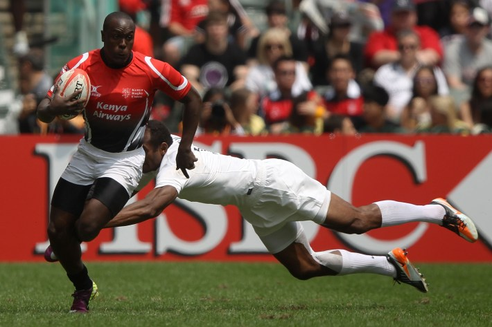 SO KON PO, HONG KONG - MARCH 24:  Felix Ayange #10 of Kenya breaks the tackle of Isoa Damu #1 of England during the match between England and Kenya on day two of the 2012 IRB Hong Kong Sevens at Hong Kong Stadium on March 24, 2012 in So Kon Po, Hong Kong.  (Photo by Chris McGrath/Getty Images)
