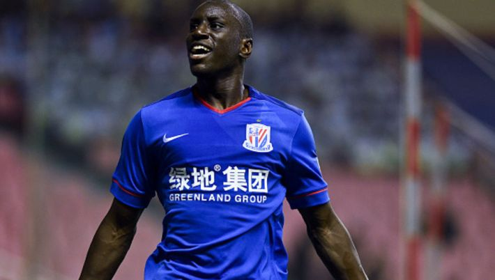 SHANGHAI, CHINA - JULY 15:  (CHINA OUT) Demba Ba #9 of Shanghai Greenland Shenhua celebrates after scoring a goal during CSL Chinese Football Association Super League match between Shanghai Greenland Shenhua and Beijing Guoan at Hongkou Football Stadium on July 15, 2015 in Shanghai, China.  (Photo by ChinaFotoPress/ChinaFotoPress via Getty Images)