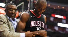 Dec 13, 2017; Houston, TX, USA; Houston Rockets forward Luc Mbah a Moute (12) is walked off the court during the second quarter Charlotte Hornets at Toyota Center. Mandatory Credit: Shanna Lockwood-USA TODAY Sports