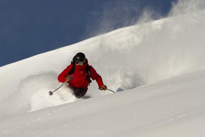 A backcountry skier making a turn in powder snow in Utah.
