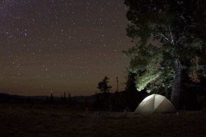 A camping tent glows under the starry sky at a campsite in Stanley, Idaho.