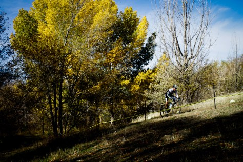 Cyclocross bike racer climbing a hill at Soldier Hollow park in Salt Lake City, Utah