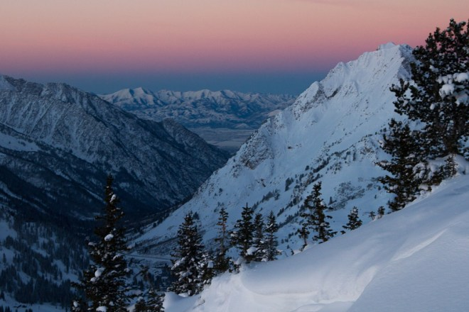 A pink and blue sky hangs over Mount Superior in Little Cottonwood Canyon, Utah.
