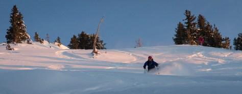 Skier Adam Riser makes a deep powder turn in Grizzly Gulch near Alta, Utah.