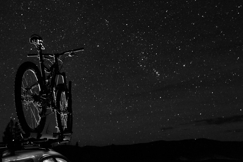 The silhouette of a bike against the star-filled sky of Stanley, Idaho