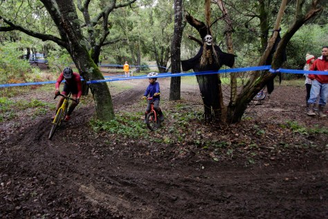 Santa Cruz Factory Racing rider Zach Wick ducking a tree on a tight corner.