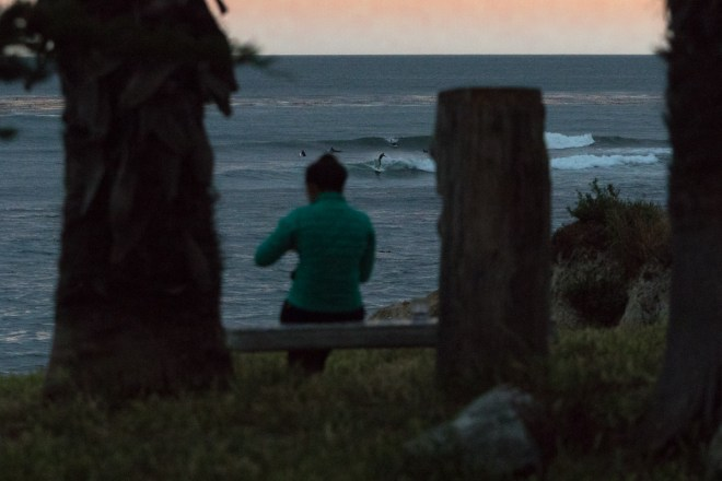 Surfers at dusk off Pleasure Point